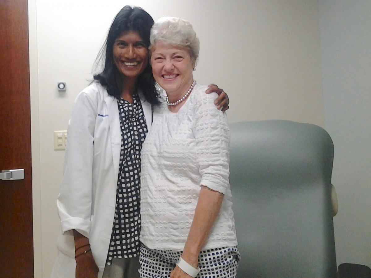 Sylvia Foushee poses with her oncologist Veshana Ramiah, MD, after she learns on June 29 that her cancer is in remission.