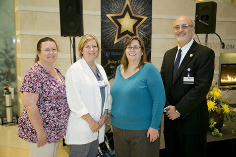 Pictured 2015 DCI Super Stars: Leann Richards, Martha Lassiter, Cheryl Morgan Maxey, and DCI executive director and event host Michael B. Kastan, MD, PhD.