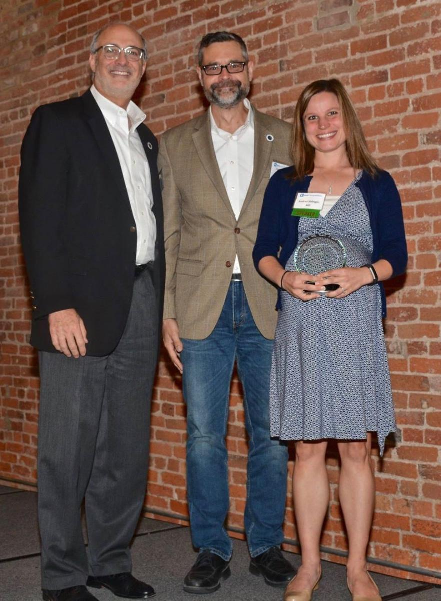 Andrea Sitlinger, MD, (right) a hematology-oncology fellow in the Yousuf Zafar Lab, receives an award in population science research from Executive Director of DCI, Michael Kastan, MD, PhD. (left) Christopher Counter, PhD is at center.