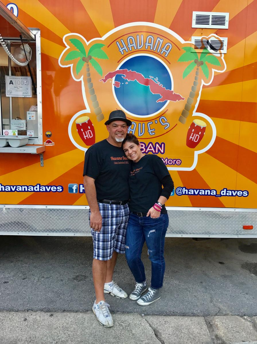 "Angie Vega and Dave Izquierdo at their Cuban sandwiches food truck, ""Havana Dave's."""