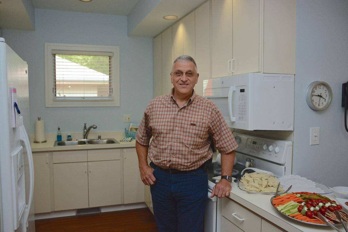 Roger Frechette, Mount Airy, North Carolina, stands in the kitchen of the newly renovated apartment at Caring House. Frechette and his wife, Kathleen Noyes, are the first to guest at the apartment which is dedicated to Duke patients undergoing bone marrow transplant. Noyes was diagnosed in 2002 with myelofibrosis, a serious bone marrow disorder disrupting the body's normal production of blood cells.