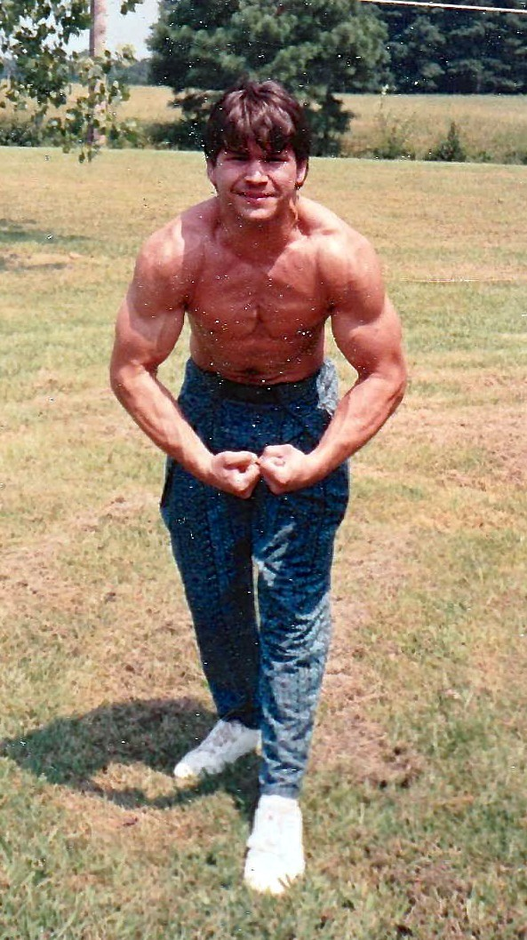 Once an amateur body builder, Gerald Madren, then in his early 20s, poses in the backyard of his home in Thomasville, Norh Carolina.