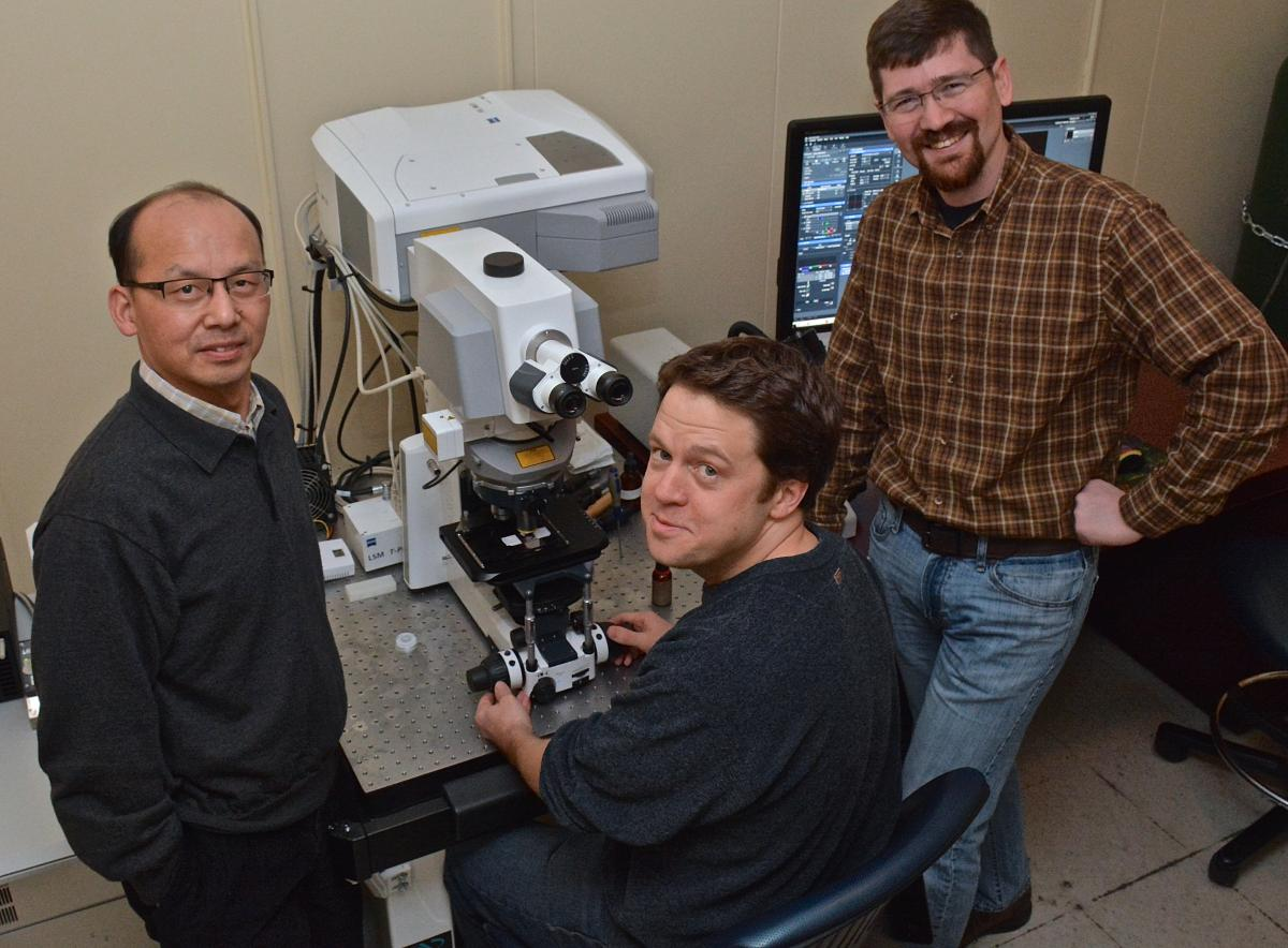 Sam Johnson, PhD, and his team, Yasheng Gao, PhD, and Ben Carlson, PhD, pose in the Research Park II lab. The trio is available for consultation and LMCF training.