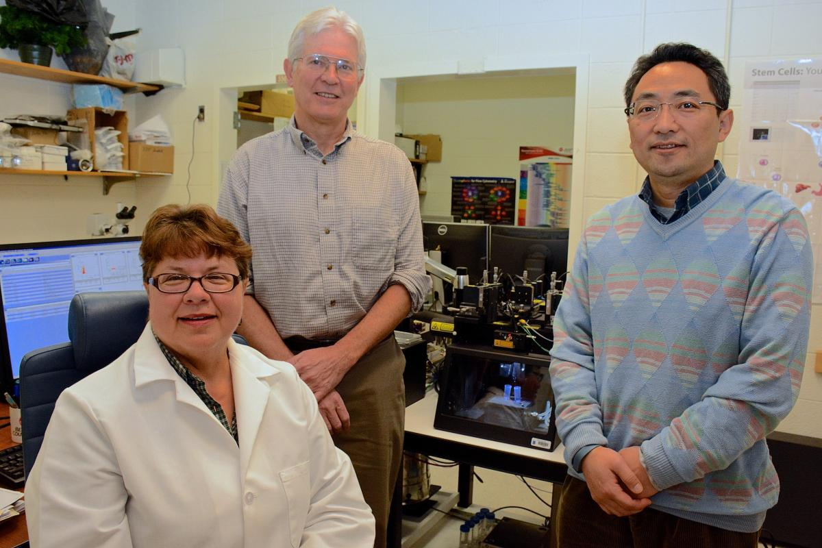 The Flow Cytometry Resource team is headed up by Michael Cook, PhD, and Michael S. Krangel, PhD. Pictured from left to right: Nancy Martin, lab research analyst II; Michael Cook, PhD; and Bin Li, PhD, lab research analysts II. Not pictured: Lynn Martinek, lab research analyst II.