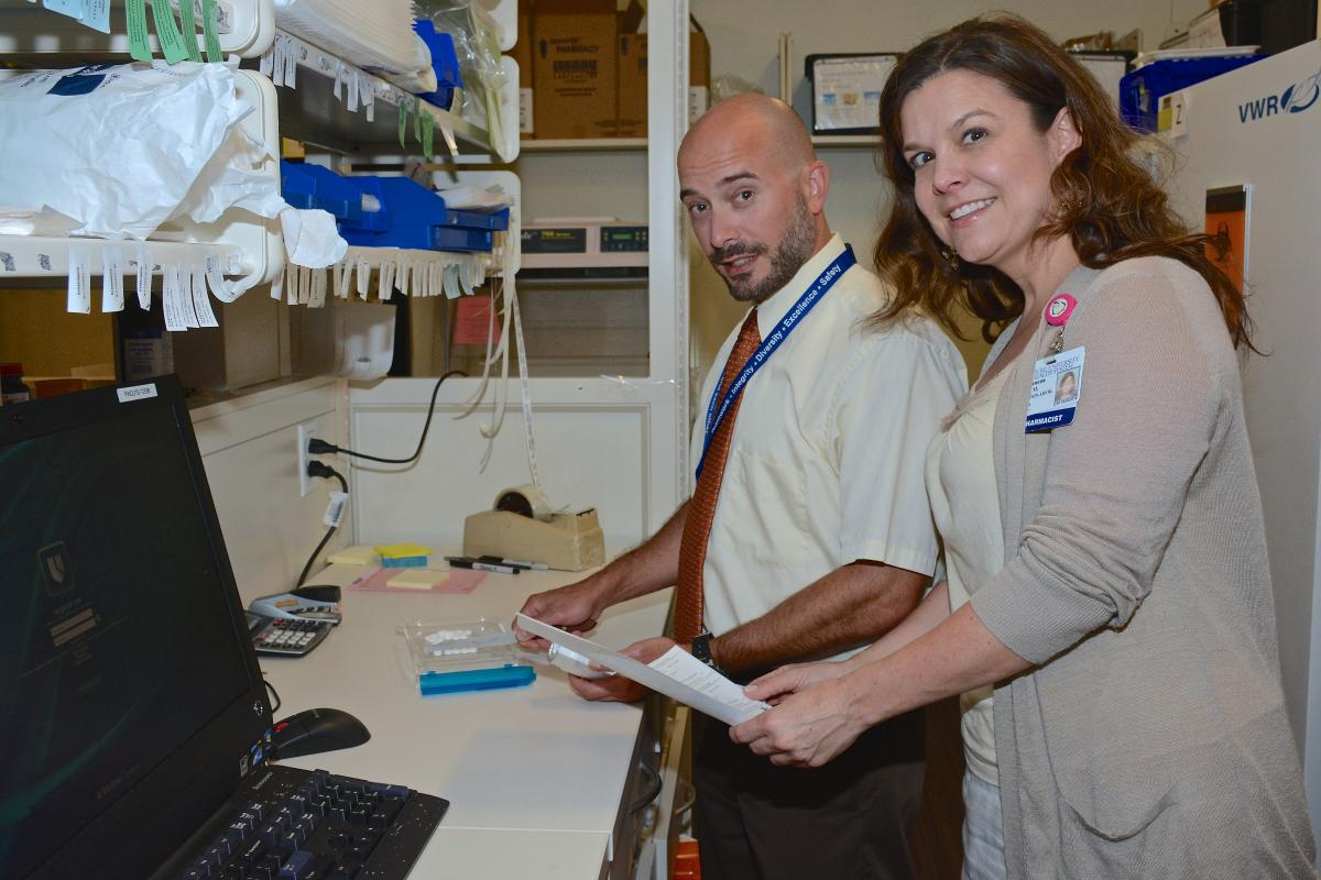 Beth McLendon-Avrik, PharmD, manager ICS/IDS, consults with colleague Martin Kowalsky, PharmD.