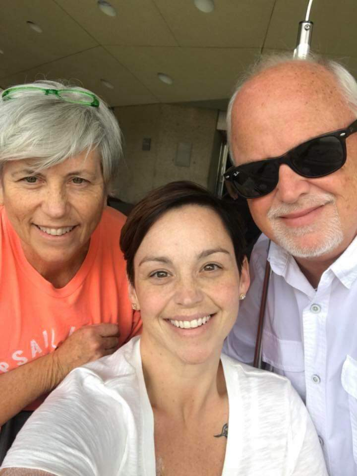 """Ashley Reaves Linden with her parentsTeri Holliday andBill Reaves. Her parents and friends call her """"a bright light."""""""