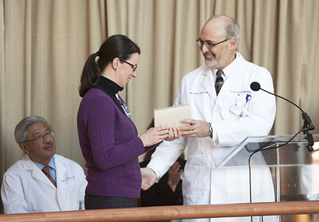 As former chancellor for health affairs at Duke University Victor Dzau, MD, looks on, Gosselin accepts a gift from DCI executive director Michael B. Kastan, MD, PhD. In 2012 at a Open House for Duke Cancer Center, Gosselin was recognized for her invaluable contributions to its formation.