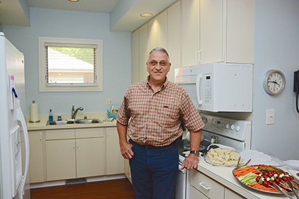 Roger Frechette, Mount Airy, North Carolina, stands in the kitchen of an apartment at Caring House. Frechette and his wife, Kathleen Noyes, were the first to guest at the apartment which is dedicated to Duke patients undergoing bone marrow transplant. Noyes was diagnosed in 2002 with myelofibrosis, a serious bone marrow disorder disrupting the body's normal production of blood cells.