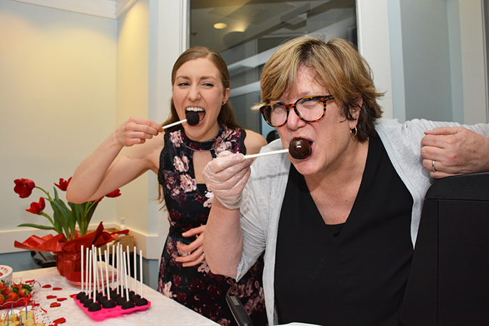 "Brittany Griffin and Diane Pinder take a dose of their own sweet ""medicine,"" a chocolate cake pop covered by chocolate fondue."