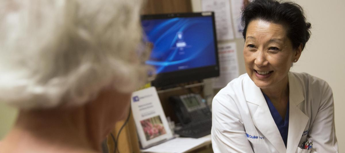 Breast surgeon E. Shelley Hwang, MD, consults with a patient.