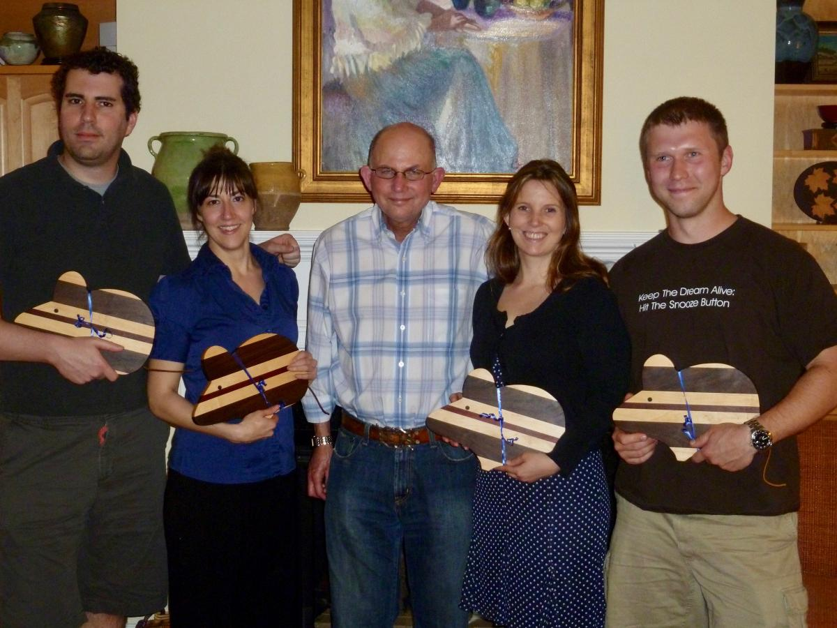 One of Mark Dewhirst's traditions has been to give PhD students an artistic rendering of a mouse when they complete their PhD degree. One year he gave his four graduating students cutting boards in the shape of a mouse made by James Oleson, MD, PhD, who was instrumental in Dewhirst's recruitment to Duke. Oleson (now retired and a master furniture maker) and Dewhirst were on the faculty together at the University of Arizona from 1979-1984 and collaborated on several projects together at Duke. [From left to right: Andrew Fontanella, Kelly Kennedy, Dewhirst, Chelsea Landon, Pavel Yarmolenko]