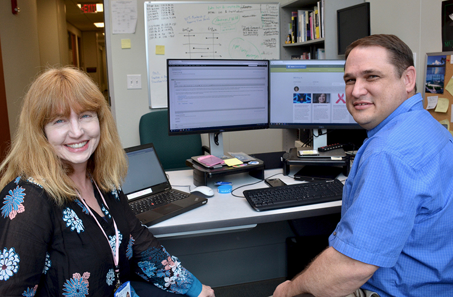 Julie Harbin, DCI writer, and Chad McLamb, DCI IT web developer, make edits to an article on Duke Cancer Institute's newly designed website. Circle photo: Brian Coffelt, DCI IT web developer, and Bose Kamineni, PhD, DCI IT manager, review the mobile responsiveness of the site's new design. DCI IT staff were instrumental in the launch of the new site.
