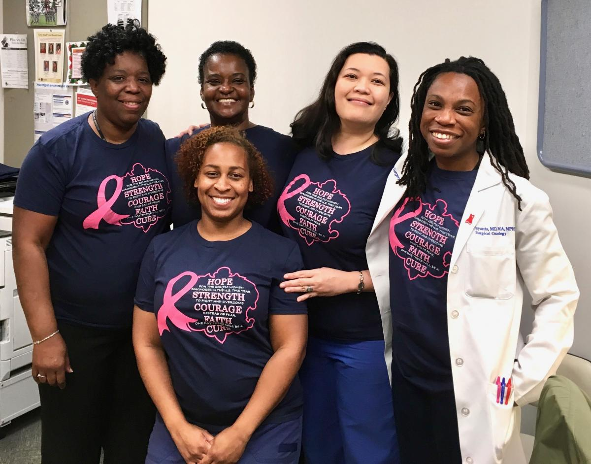CAPTION: Duke Cancer Institute breast surgeon Lola Fayanju, MD (far right), the director of the Breast Clinic at the Durham Veterans Affairs Medical Center,  joins her breast clinic staff for a team photo on June 15.