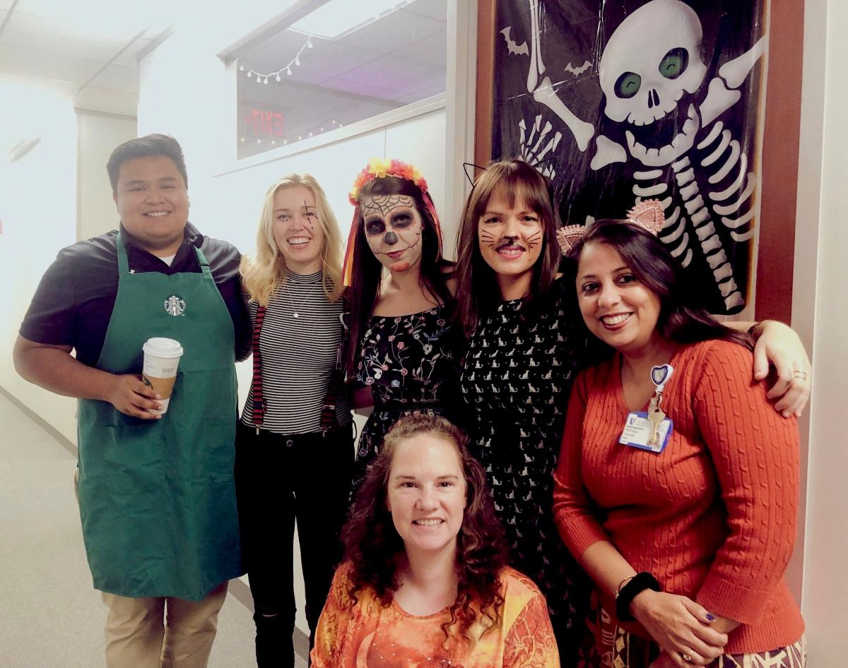 A costumed crew from DCI Prostate & Urologic Oncology research and communications show team spirit.