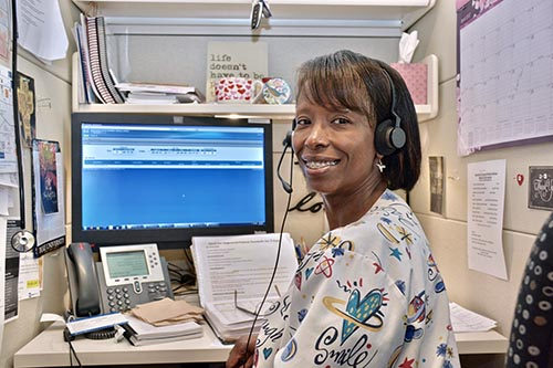 Working as a nurse in Duke Cancer Institute's Central Triage, Heather Ebron, RN, BSN, OCN, responds to patient inquiries.