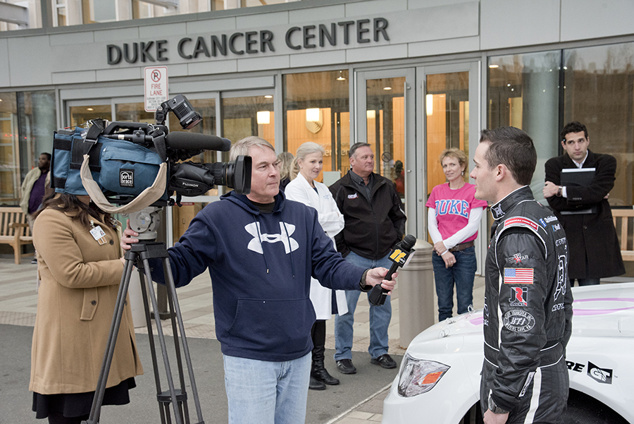 At a recent visit to Duke Cancer Center on Feb. 3, ARAC race car driver Quin Houff is interviewed by reporters with ABC 11 while Kimberly Blackwell, MD and Zane and Kate Houff look on.