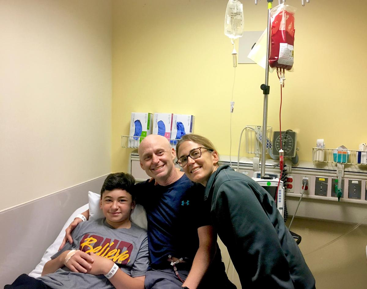 Bone marrow donor Jake Zaas, 13, and his parents, David and Aimee. Over the summer Jake donated his bone marrow to his dad, David, who had been diagnosed with leukemia earlier this year.