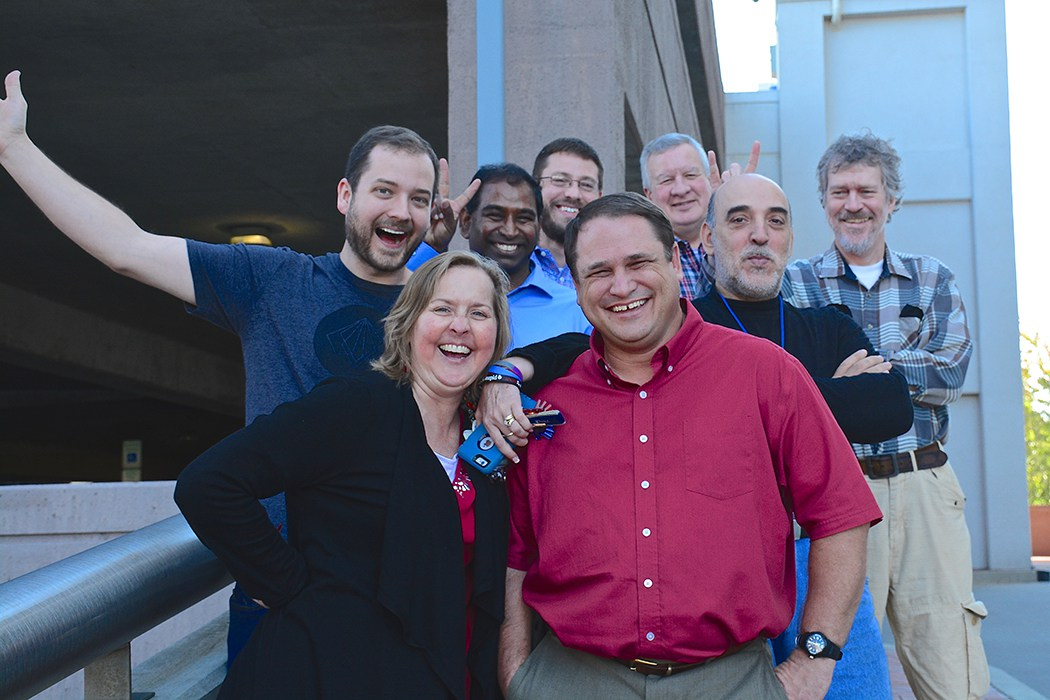 From front to back: Front left – Erin Wood, IT Analyst; Chad McLamb, Senior IT Analyst; Stephen Adams, Linux System Administrator; Right, Manuel Rosa, IT Analyst; Bose Kamineni, Manager, Application and Database; Michael Goodin, IT Analyst; Seth Fehrs, IT Analyst; Tim Steele, Clinical Research Informatics Manager. (Missing: Mark Peedin, Senior IT Analyst; Michael Leonard, Project Coordinator III; Geoff Chenger, Helpdesk Manager; Adebola Jokogbola, IT Analyst; Aaron Crallie, IT Analyst)