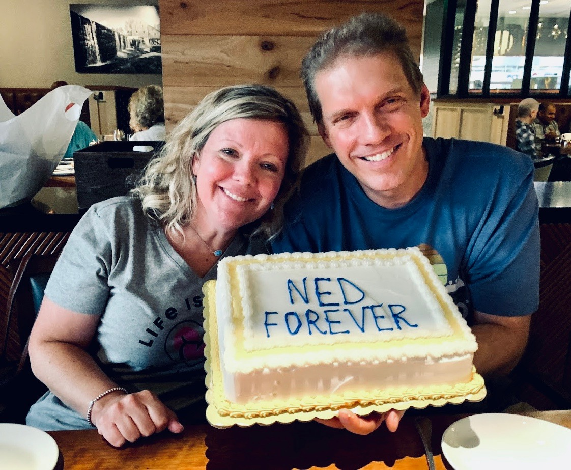 David and Amy Gira and the N.E.D. cake
