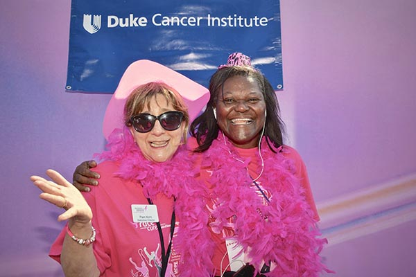 While hosting last year's 5K, Kohl enjoys a moment of levity at the DCI's photo booth as she poses with Valarie Worthy, MSN, RN, DCI patient navigation manager.