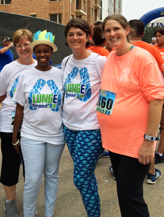 Nine months pregnant with her third child, Kristen Walden (right) poses with members of her Duke Cancer Center Raleigh team, the Duke Raleigh Lung Rangers. Walden captains the team along with lung cancer specialist Jennifer Garst, MD.
