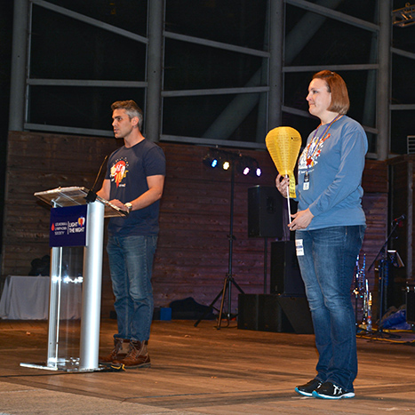 Center stage, Duke radiation oncology nurse Nicole Kenney, BSN, RN, OCN, CNIII, lights the night last year in memory of her mother, Noreen. Kenney captains Team Noreen, which has raised thousands of dollars over the years in support of LLS.