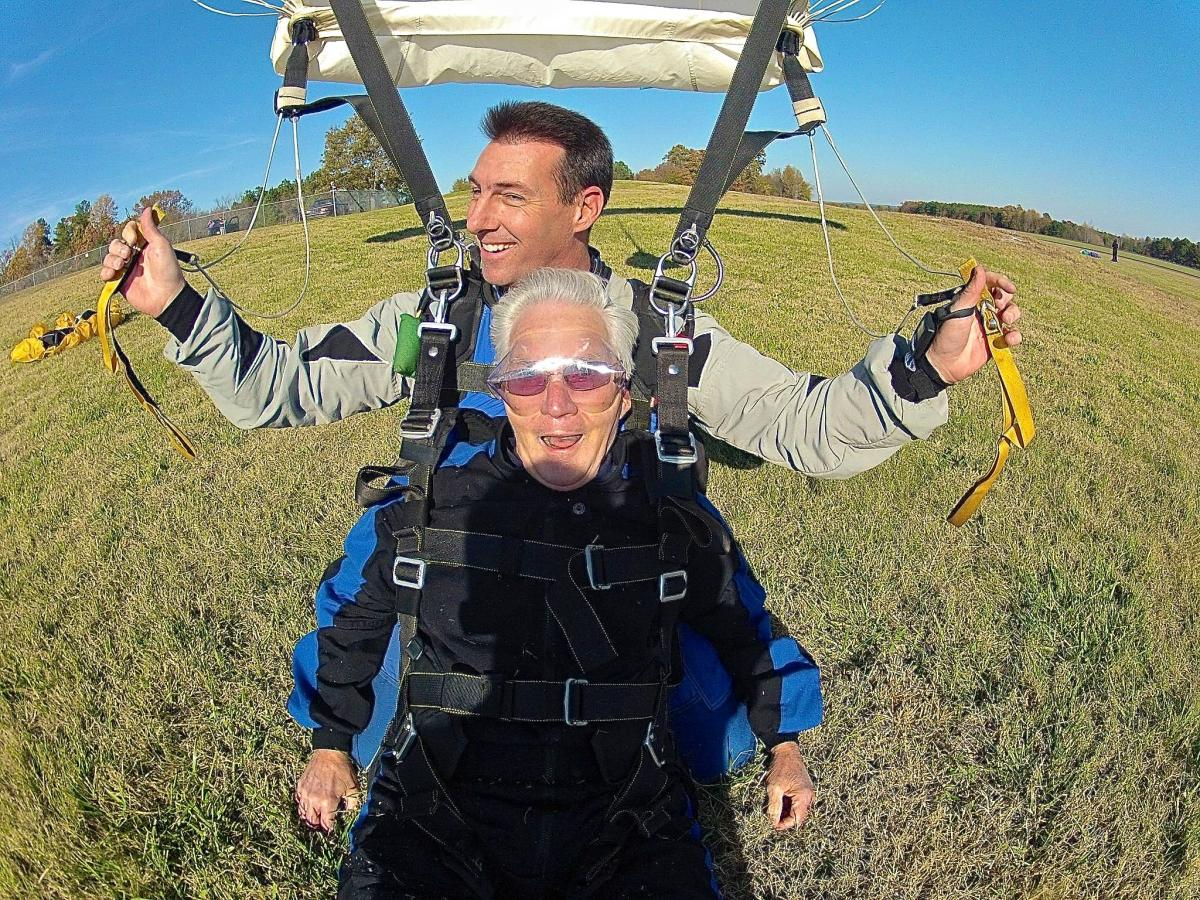 Lung cancer survivor Bob Norris lands safely back to earth after jumping with his tandem partner Gregg Upper. Norris is gearing back up for his third jump Nov. 9 at Triangle Skydiving Center in Louisburg.
