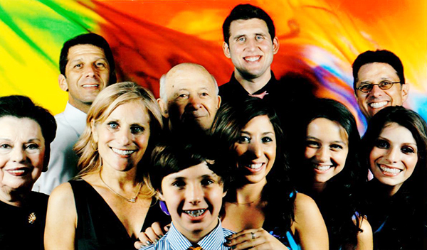 Before he passed from the effects of a glioblastoma brain tumor, Oren Margol (far right back) poses with his family, including (from left to right) his mother, Barbara; Drew Margol's wife, Michelle; Oren's son, Joel; Drew's daughter, Gabrielle; Oren's daughter, Eden; Drew's daughter, Lauren Trager; Drew (back left); Oren's father, Bennie; and Drew's son-in-law, Brandon Trager.