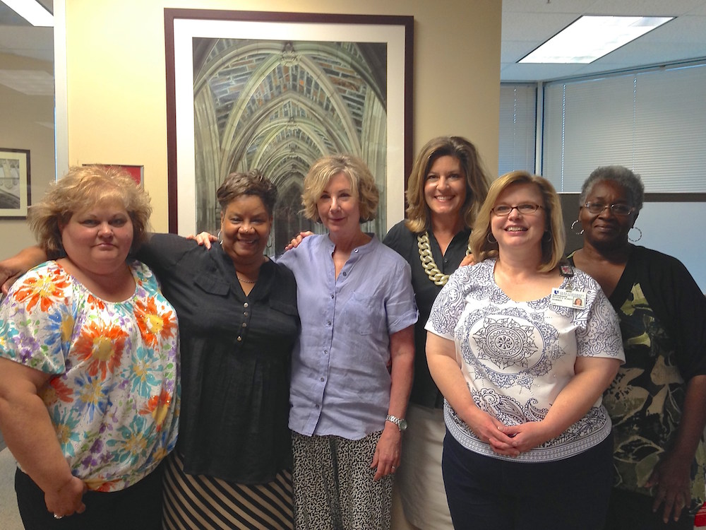 At her farewell party, Patty Croom (center) poses with members of the original DCRC team. From left to right: Teresa Renn, Service Access Manager; Jackie Bobbitt, retired in 2012; Patty Croom; Genese Newman, Director, DCRC; Karen Harris, Program Specialist; and Ella Gentry, retired May 2014.