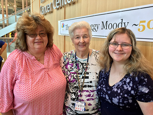 "Peggy Moody (center) poses with her daughter, Lynne, and granddaughter, Lindsey Kirby, 18. In remission, Lynne has battled both breast and brain cancers. Lindsey Kirby will attend the University of North Carolina where she hopes to earn a PharmD degree. ""This is what keeps Mom going — it's what gets her up each day,"" commented Lynne on her mother's lengthy years of service."