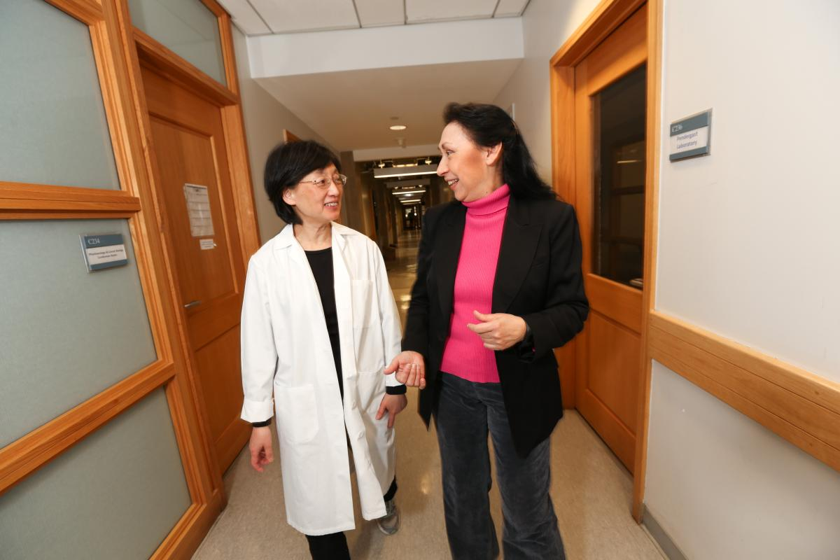 Ann Marie Pendergast, PhD (right) consults with senior research scientist Jing Jin Gu, PhD, who initiated the research on brain metastasis in the Pendergast Lab. (Huth Photo)