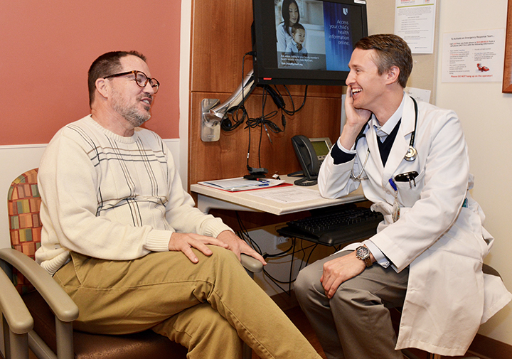 Medical oncologist Thomas LeBlanc, MD, shares a moment of levity with his patient Greg, now a cancer survivor.