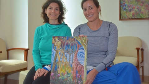 Cardillo and Secord pose with Cardillo's artwork, a gift to Secord.