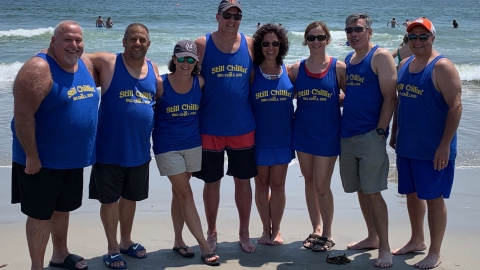 Sarcoma survivor Michael Salamone, his wife Melanie and friends on the beach, 2019