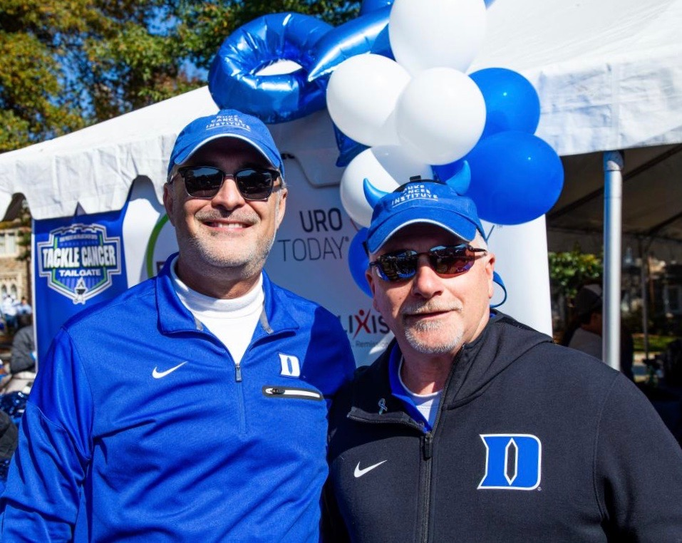 Duke Cancer Institute director Michael Kastan, MD, PhD, and deputy director Steven Patierno, PhD, attend the first annual Tackle Cancer Tailgate — hosted by the DCI Center for Prostate & Urologic Cancers in November 2018.