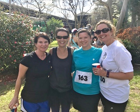 Rectal cancer survivor Tina Escalona (far right) is pictured, not too long ago, with her friends at a 5K. This year she's going to lace up for the first time for the CRUSH Colorectal Cancer Run/Walk — supporting Duke Cancer Institute research, community outreach and education.