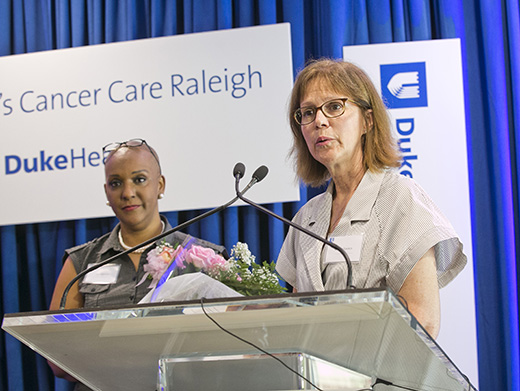 Lisa Tolnitch, MD, welcomes guests at the 2016 grand opening of Duke Women's Cancer Care Raleigh.