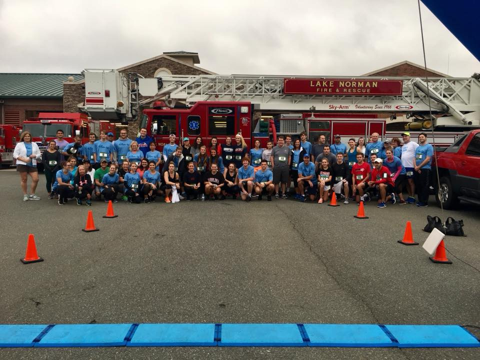 Runners prepare for the inaugural Blue Ribbon 5K held in memory of Rick Symons.