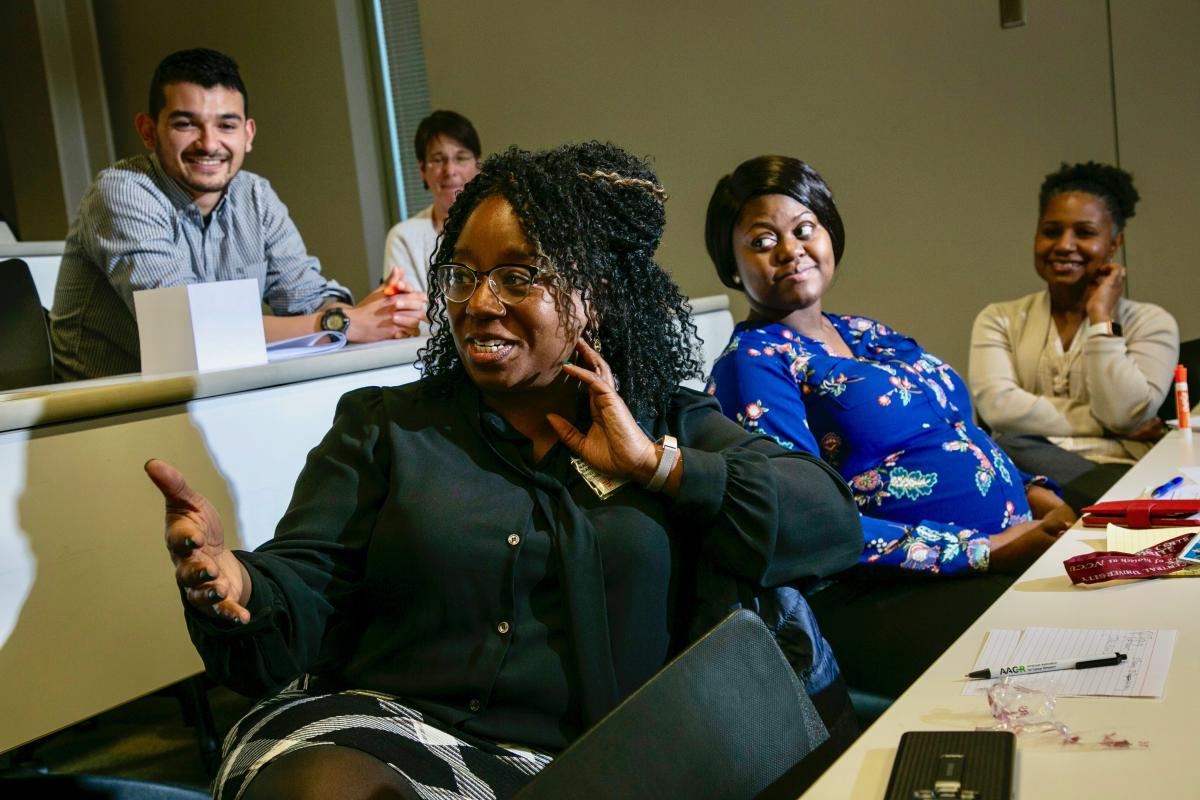 Nadine Barrett, PhD, (far left) engages with students and faculty at a mentor-mentee communications workshop for the second cohort of students taking part in the Duke/North Carolina Central University Cancer Research and Education Program. Barrett is co-director of that program. (photo by Chris Hildreth)