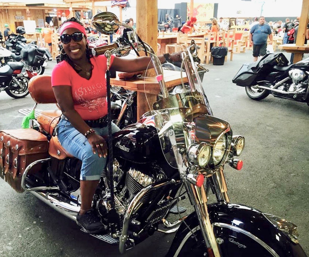 Here's Wyndi Smith in July 2015 at the Sturgis Motorcycle Rally in South Dakota. Though not a biker herself, she enjoys a ride when offered.