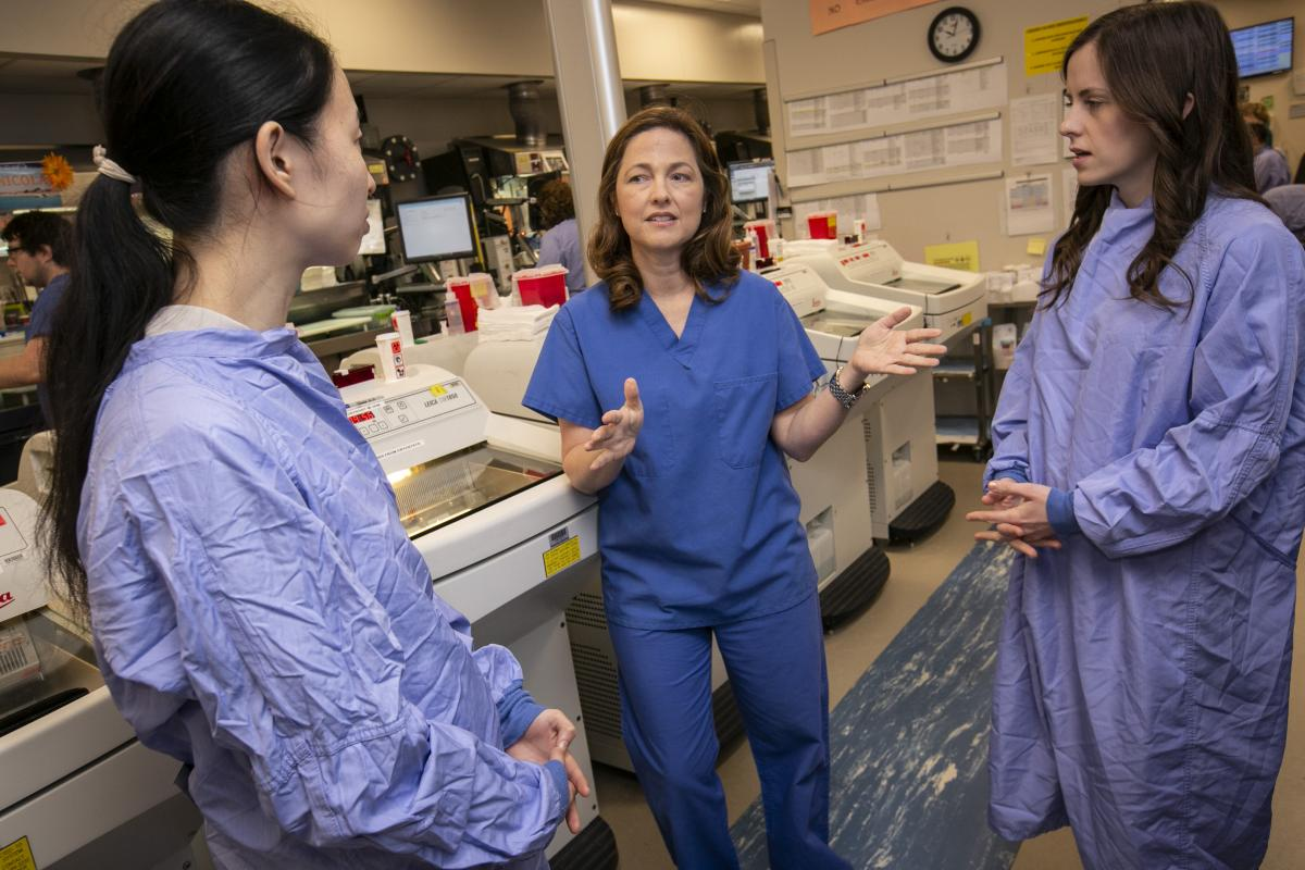 "This spring, pathologist Shannon McCall, MD, has students of Gerald Blobe, MD, PhD, and David Hsu, MD, PhD, part of the molecular oncology group, shadowing her in the Surgical Pathology Lab. ""From my perspective we've had a wonderful teaching experience,"" said McCall. ""On this day in particular they got a chance to see how a surgeon needed a pathologist's input in real time."""