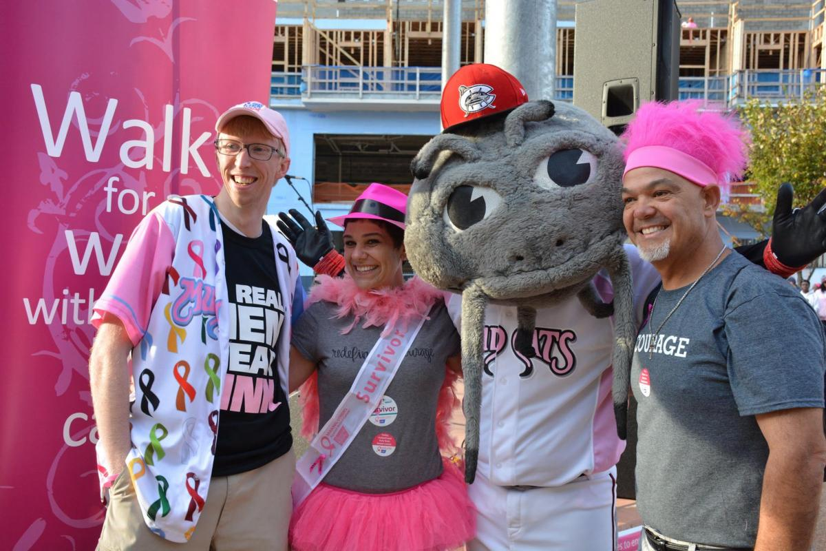 Angie Vega (center) and her husband Dave Izquierdo (far right) with the Carolina Mudcats mascot and a friend at Making Strides of Raleigh 2016.