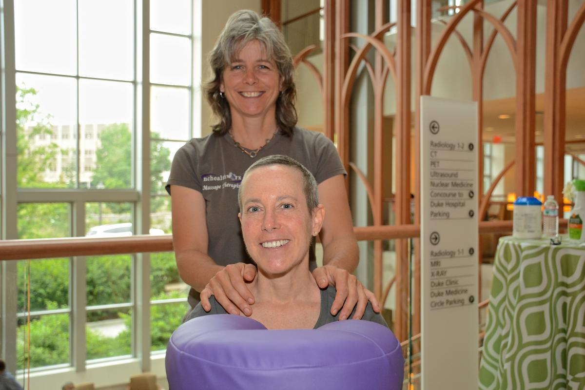 Liz Marchese, Durham, takes time to enjoy a relaxing massage from massage therapist Donna DeVanney. Marchese is battling stage 4 lung cancer.