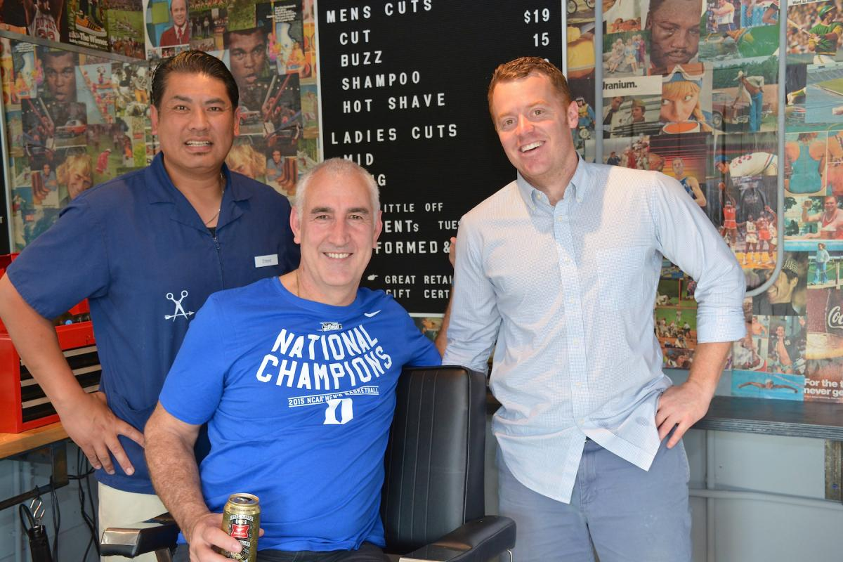 Pete Phipps, owner and operator of Pedro Williams and Arrow Haircuts, poses with his barber, Steve, and client, Paul Villanti, of the Movember Foundation.