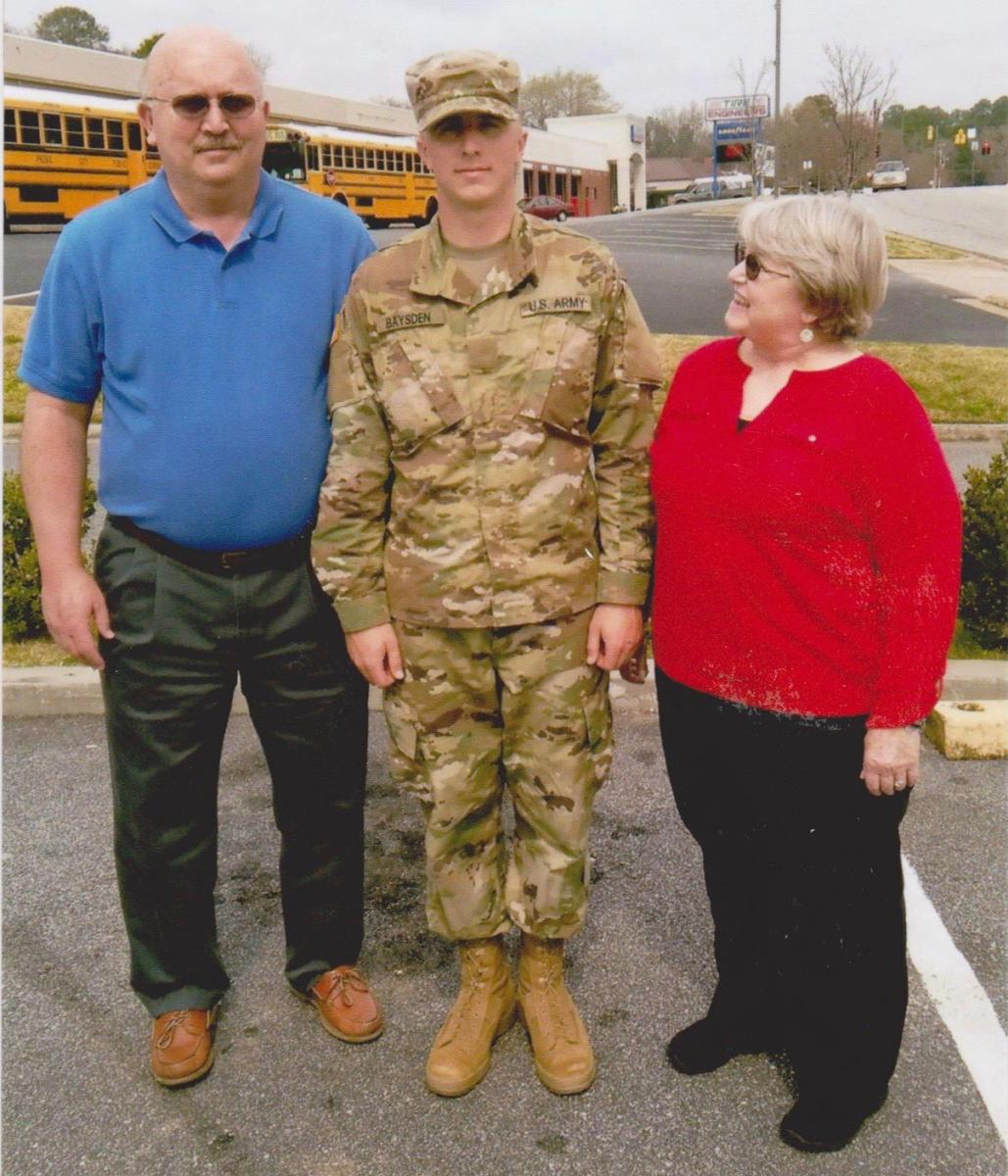 Ken Baysden had brain tumor surgery last May shortly after their son Carl's graduation from basic training at Fort Benning, Georgia (with Ginny above). Recently cleared of his tumor, Ken proudly showed-off their airman son around town when Carl returned home to Morehead City, NC, this Christmas.
