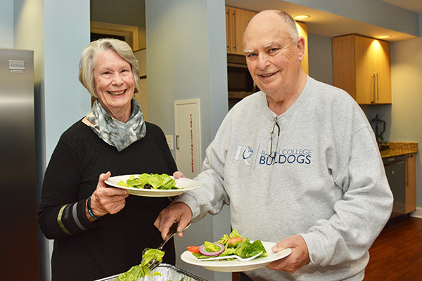 """Paul and Betsy Brewer, of North Myrtle Beach, South Carolina, start with the salad. """"This is wonderful,"""" said Paul. """"Having a home cooked meal prepared for us means one less thing to worry about."""""""