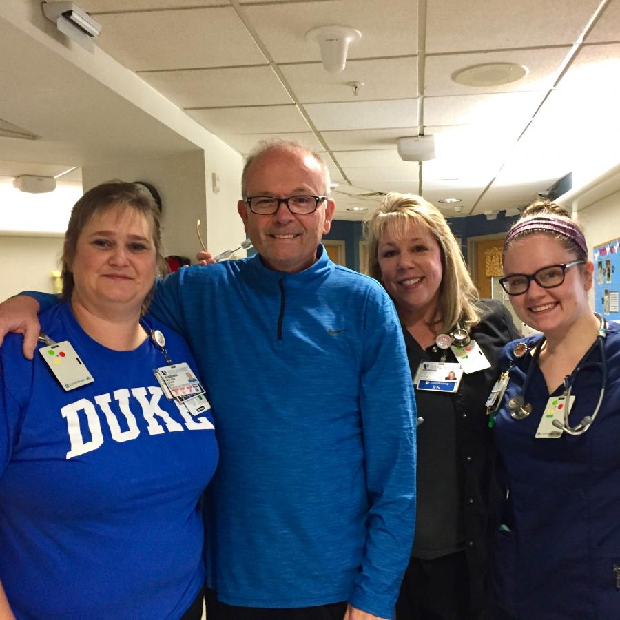 Tonsil cancer survivor Robert Russell with the nurses of the ninth floor of Duke Medical Center, whom he regularly visits and thanks for his care. (click photo to read his cancer story)