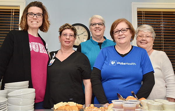 Pictured left to right: Janelle Blossingham, RN, BSN, Melanoma; Suzanne Matkins, CMA, Thoracic; Andrea Gillespie, RN, BSN, Thoracic; Lisa Anderson, RN, BSN, Thoracic; and Blossingham's mother, Karen Swathwood. Not pictured: Evan Dropkin, PA; Karen Bronson, RN; Hansel Bosarge, RN; and Gerardo Chavez, RN.