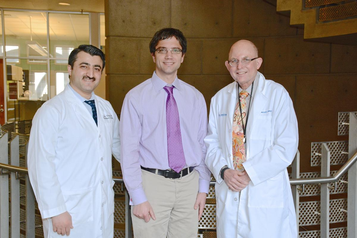 Mark Dewhirst, PhD, DVM (right) and Greg Palmer, PhD (center), co-directors of the Optical Molecular Imaging and Analysis shared resource, with Gabi Hanna, MD, associate director of the Optical Molecular Imaging and Analysis.