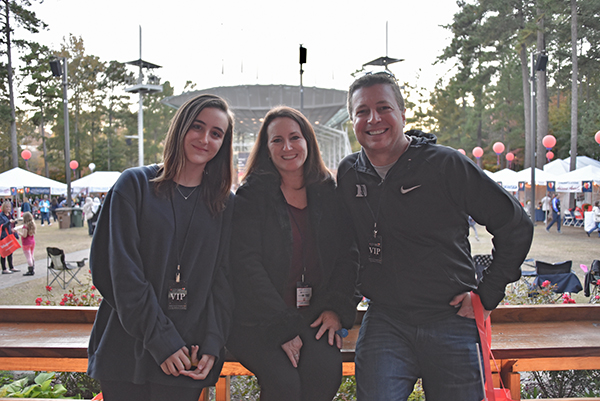 Student of the Year nominee Quinn Tobin (left) poses with her mother, Kathy, and her father, Jim, while attending the 2018 LLS Light The Night walk at Booth Amphitheatre in Cary, North Carolina.
